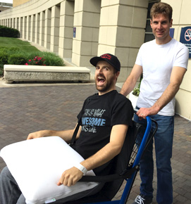 2014 Verizon IndyCar Series champion Will Power, right, pushes James Hinchcliffe's wheelchair following Hinchcliffe's release from IU Health Methodist Hospital on May 26. Click the image to download a high-res version.
